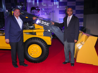 P Ravishankar, CEO and V Sumantran, Chairman of Ashok Leyland John Deere Construction Equipment Company with 435E backhoe loader