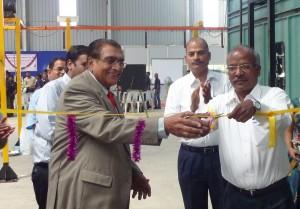 Wabco India Managing Director P Kaniappan (right) inaugurating the Powder Coating facility along with the Managing Director of Rajsriya Automotive, P S Govindachari