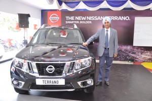 Satinder Singh Bajwa, Vice President – Sales, Network and Customer Relations, Nissan Motor India Pvt. Ltd posing with the new Nissan Terrano